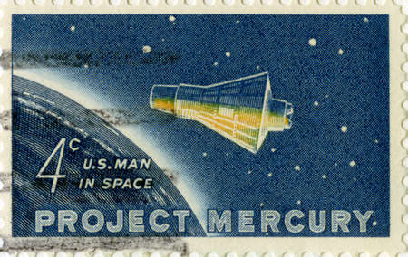 postage stamp: UNITED STATES, CIRCA 1962: A vintage US Postage Stamp celebrating the First American Man in Space, circa 1962.