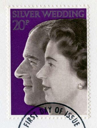 silver wedding anniversary: UNITED KINGDOM - CIRCA 1972: A vintage British postage stamp celebrating the Royal Silver Wedding Anniversary of Her Majesty Queen Elizabeth II and Prince Phillip, circa 1972. Editorial