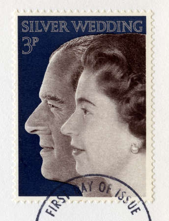 the majesty: UNITED KINGDOM - CIRCA 1972: A vintage British postage stamp celebrating the Royal Silver Wedding Anniversary of Her Majesty Queen Elizabeth II and Prince Phillip, circa 1972. Editorial