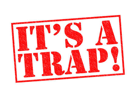 ITS A TRAP! red Rubber Stamp over a white background. photo