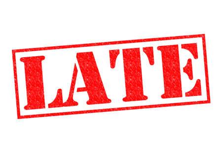 llegar tarde: LATE sello de goma de color rojo sobre un fondo blanco. Foto de archivo