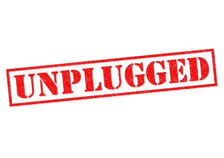 unplugged: UNPLUGGED red Rubber Stamp over a white background.
