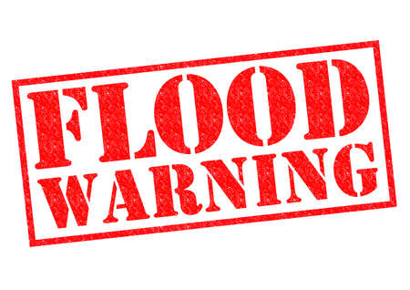 FLOOD WARNING red Rubber Stamp over a white background. photo