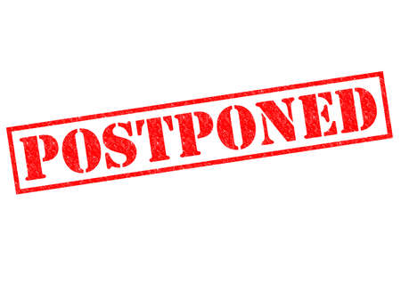 POSTPONED red Rubber Stamp over a white background. photo