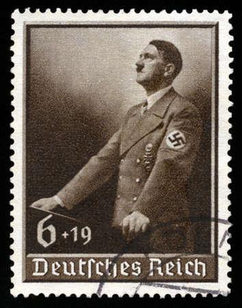 swastika: GERMANY - CIRCA 1939: A vintage German Reich Postage Stamp portraying an image Adolf Hitler, circa 1939.