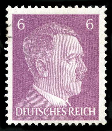 nazis: GERMANY - CIRCA 1941: A vintage German Reich Postage Stamp portraying an image Adolf Hitler, circa 1941.