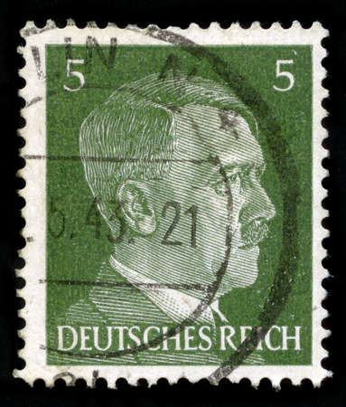 nazism: GERMANY - CIRCA 1941: A vintage German Reich Postage Stamp portraying an image Adolf Hitler, circa 1941.
