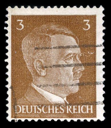 adolf hitler: GERMANY - CIRCA 1941: A vintage German Reich Postage Stamp portraying an image Adolf Hitler, circa 1941.