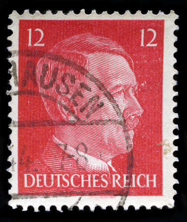 fascism: GERMANY - CIRCA 1942: A vintage German Reich Postage Stamp portraying an image Adolf Hitler, circa 1942. Editorial