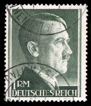 nazism: GERMANY - CIRCA 1945: A vintage German Reich Postage Stamp portraying an image Adolf Hitler, circa 1945.