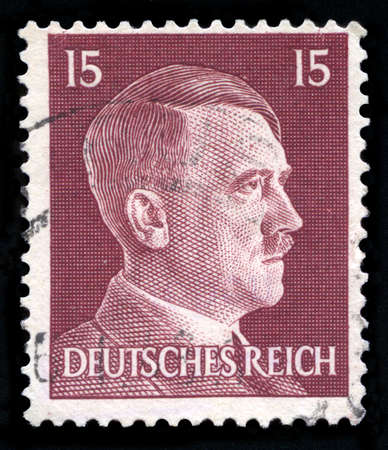 genocide: GERMANY - CIRCA 1942: A vintage German Reich Postage Stamp portraying an image Adolf Hitler, circa 1942. Editorial