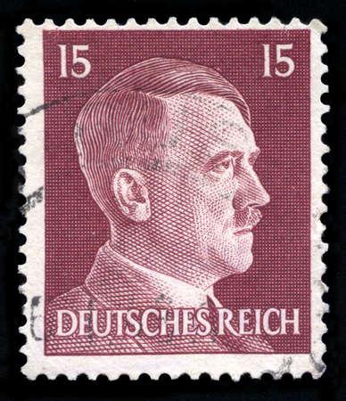 adolf hitler: GERMANY - CIRCA 1942: A vintage German Reich Postage Stamp portraying an image Adolf Hitler, circa 1942. Editorial