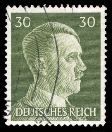 GERMANY - CIRCA 1945: A vintage German Reich Postage Stamp portraying an image Adolf Hitler, circa 1945.