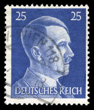 genocide: GERMANY - CIRCA 1945: A vintage German Reich Postage Stamp portraying an image Adolf Hitler, circa 1945.