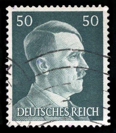 adolf hitler: GERMANY - CIRCA 1945: A vintage German Reich Postage Stamp portraying an image Adolf Hitler, circa 1945.