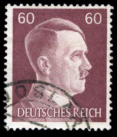 GERMANY - CIRCA 1945: A vintage German Reich Postage Stamp portraying an image Adolf Hitler, circa 1945.