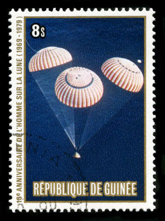 REPUBLIC OF GUINEA - CIRCA 1979: A postage stamp from the Republic of Guinea commemorating the 10th Anniversary of the Apollo 11 Moon Landing, circa 1979. photo