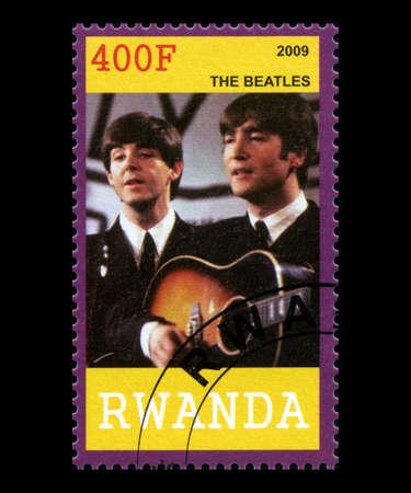RWANDA, AFRICA - CIRCA 2009: A postage stamp from Rwanda portraying an image of John Lennon and Paul McCartney of The Beatles, circa 2009.
