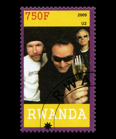 bono: RWANDA, AFRICA - CIRCA 2009: A postage stamp from Rwanda of the band U2, circa 2009.