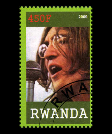 john lennon: RWANDA, AFRICA - CIRCA 2009: A postage stamp from Rwanda portraying an image of John Lennon of The Beatles, circa 2009.