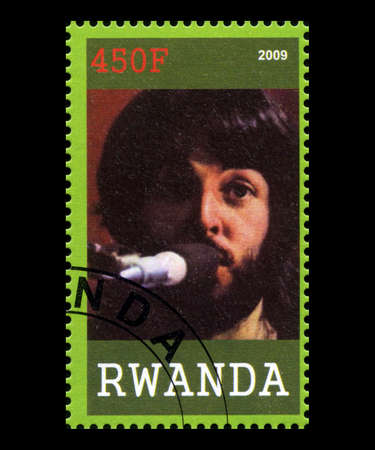 RWANDA, AFRICA - CIRCA 2009: A postage stamp from Rwanda portraying an image of Paul McCartney of The Beatles, circa 2009.