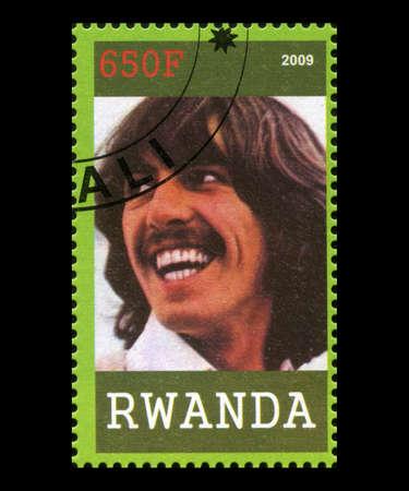 RWANDA, AFRICA - CIRCA 2009: A postage stamp from Rwanda portraying an image of George Harrison of The Beatles, circa 2009.