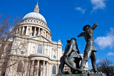 The National Firefighters Memorial in the City of London with St. Pauls Cathedral in the background. photo
