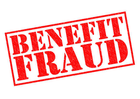 BENEFIT FRAUD red Rubber Stamp over a white background. photo