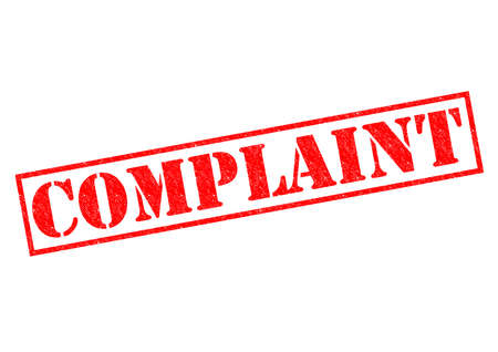 COMPLAINT red Rubber Stamp over a white background. Stock Photo