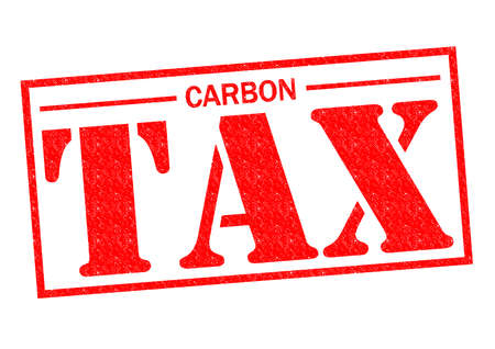 levied: CARBON TAX red Rubber Stamp over a white background. Stock Photo
