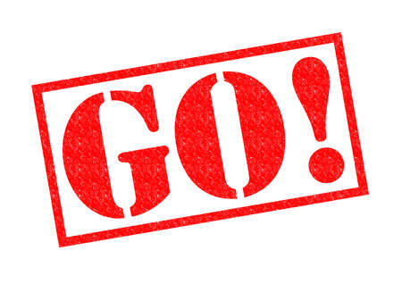 hurrying: GO! Rubber Stamp over a white background. Stock Photo