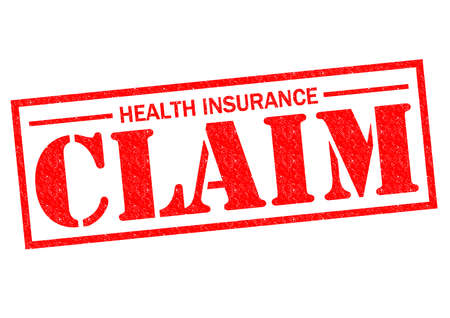 HEALTH INSURANCE CLAIM red Rubber Stamp over a white background. photo