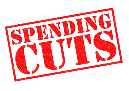 spending: SPENDING CUTS red Rubber Stamp over a white background.