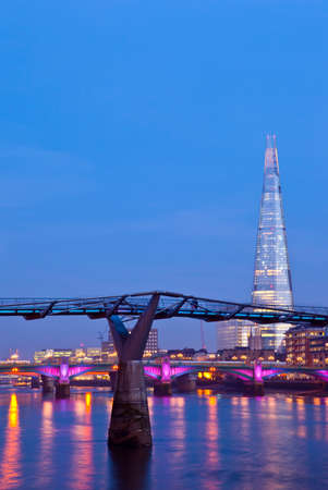 shard: The Shard and the Millennium Bridge in London  Stock Photo