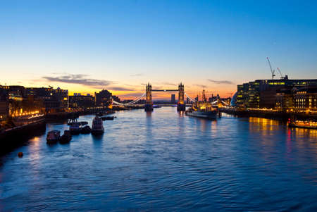 London sunrise with Tower Bridge, City Hall, HMS Belfast and the River Thames in the foreground  photo