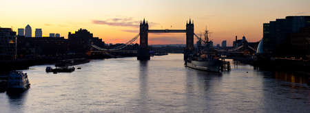 A panoramic view of a London Sunrise taking in the sights of the river Thames, Tower Bridge, HMS Belfast and Docklands  photo