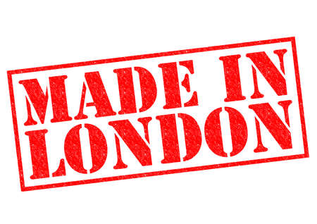 MADE IN LONDON red Rubber Stamp over a white background. photo