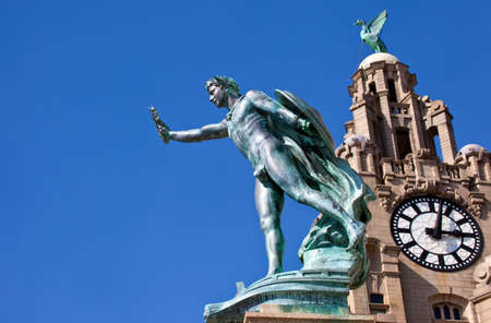 The Cunard War Memorial with the Royal Liver Building in the background. The memorial was designed by the architect Arthur Davis and made by the sculptor Henry Pegram, Liverpool, England
