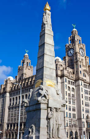 The Memorial to the Engine Room Heroes, designed by Sir William Goscombe John in 1916   The Royal Liver Building can be seen in the distance  Liverpool, England