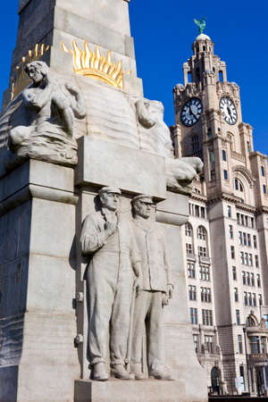 engine room: The Memorial to the Engine Room Heroes, designed by Sir William Goscombe John in 1916.  The Royal Liver Building can be seen in the distance. Liverpool, England. Editorial