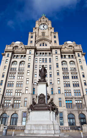 The historic Royal Liver Building and the Alfred Lewis Jones Memorial in Liverpool, England.