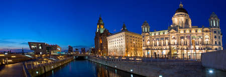 liverpool: A twilight panoramic view of the Three Graces in Liverpool  The Royal Liver Building, Cunard Building and the Port of Liverpool Building