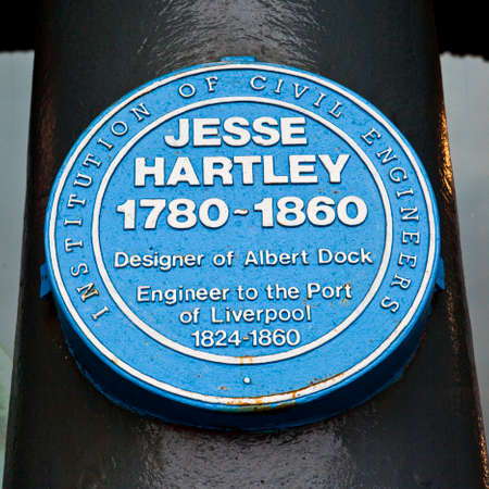 A blue plaque by the Institution of Civil Engineers at the Albert Dock in Liverpool, dedicated to Jesse Hartley who designed the Albert Dock.