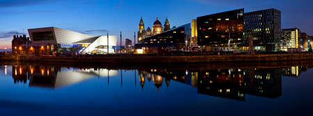 The beautiful panoramic view of the Liverpool Pier Head taken from the Albert Dock.  The view takes in sights including the Museum of Liverpool, the Royal Liver building, the Port of Liverpool building and Mann Island.