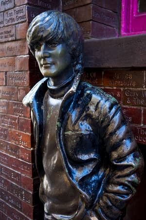 A statue of John Lennon situated opposite the historic Cavern Club in Liverpool.