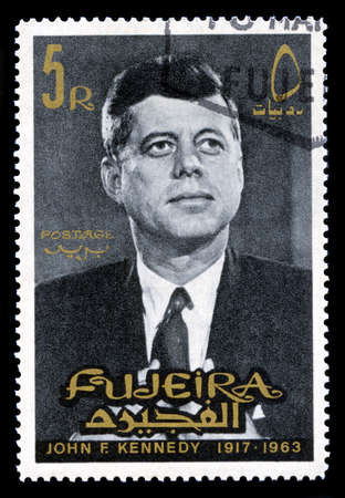 FUJEIRA, CIRCA 1965: A vintage Postage Stamp from Fujeira featuring a portrait of former President of the United States John F. Kennedy, circa 1965.