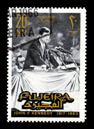FUJEIRA, CIRCA 1965: A vintage Postage Stamp from Fujeira featuring an image of former President of the United States John F. Kennedy, circa 1965.