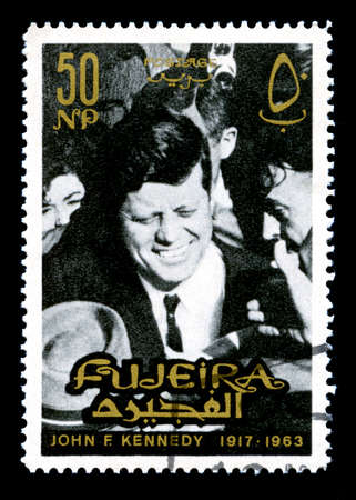fujeira: FUJEIRA, CIRCA 1965: A vintage Postage Stamp from Fujeira featuring an image of former President of the United States John F. Kennedy, circa 1965.