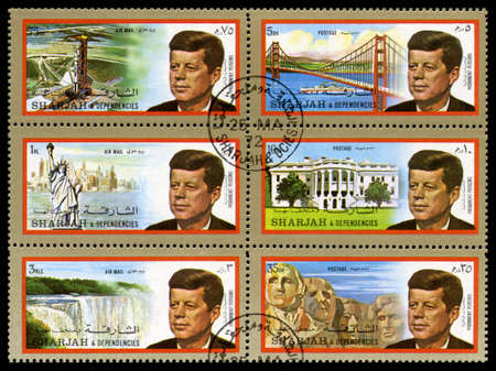 SHARJAH, CIRCA 1972: A set of Postage Stamps from Sharjah each showing a portrait of former President of the United States John F. Kennedy and an American Landmark, circa 1972.
