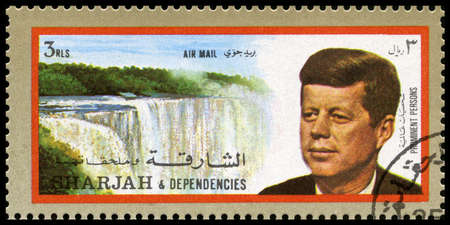 dependencies: SHARJAH, CIRCA 1972: A Postage Stamp from Sharjah showing a portrait of former President of the United States John F. Kennedy, circa 1972. Editorial